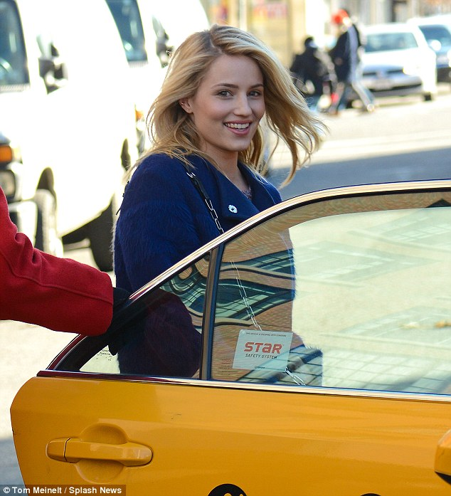 Glowing: Dianna was positively radiant as she stepped into a cab