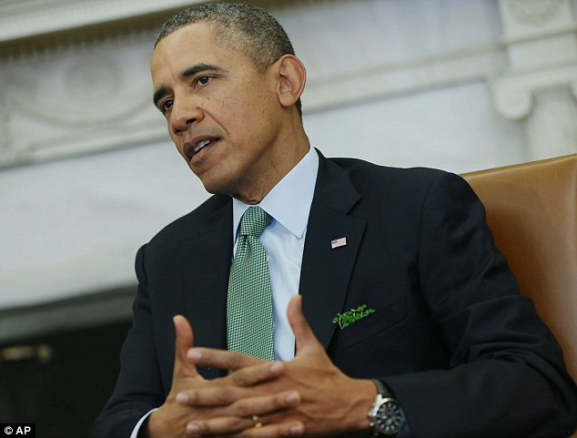 President Barack Obama, wearing a green tie and with shamrock in the breast pocket of his suit, makes a statement to reporters during his meeting with Irish Prime Minister Enda Kenny today