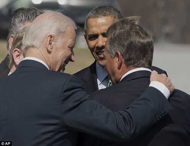 Vice President Joe Biden, left, puts his arm around House Speaker John Boehner of Ohio, right, as they speak with President Barack Obama as they leave a Friends of Ireland luncheon on Capitol Hill today