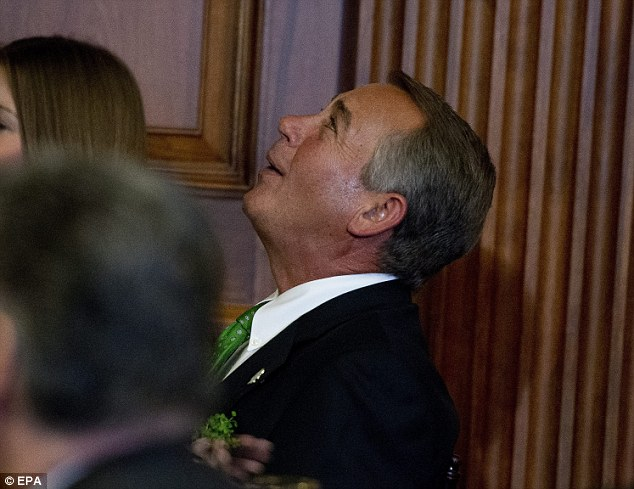 Speaker of the U.S. House of Representatives John Boehner listens to music at a St. Patrick's Day luncheon hosted by Members of Congress