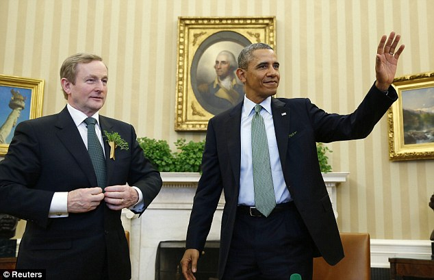 U.S. President Barack Obama waves next to Irish Prime Minister Enda Kenny in the Oval Office of the White House in Washington