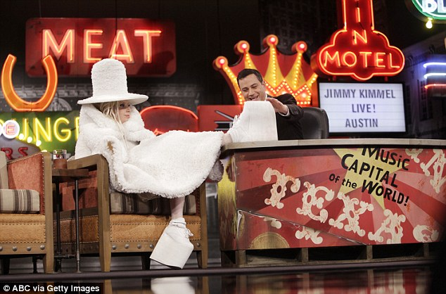 All white on the night: Joking that she was wearing the crazy garment - created by designer Gareth Pugh - to cover her recent 'weight gain', the Mother Monster was swathed from head to toe in fluffy white fabric, with not an inch of her skin on show
