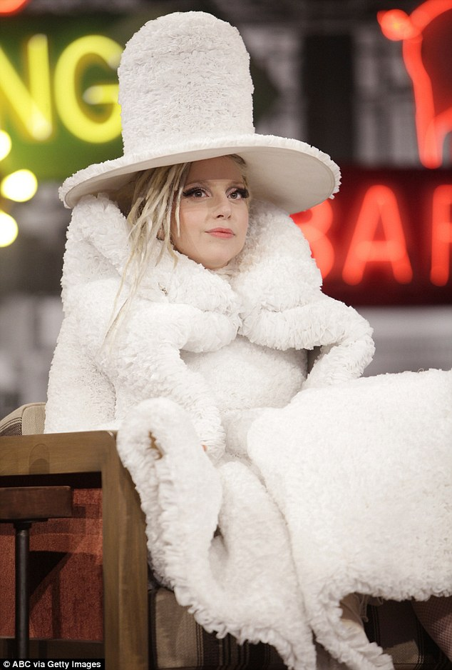 Caffeine fix: Lady Gaga was sporting one of her most bizarre ensembles to date when she appeared on Jimmy Kimmel Live on Thursday night sporting a quirky outfit made entirely out of coffee filters