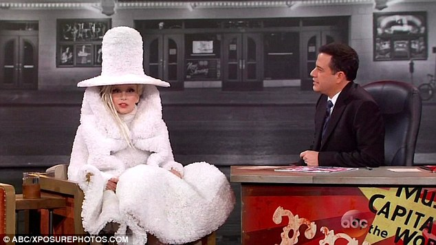 Kooky: Gaga completed her bonkers outfit with platinum dreadlocks and complemented her alabaster skin with pale powder and a set of dramatic false fluttering lashes