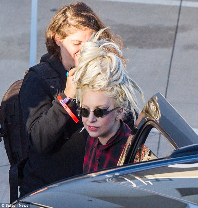 Off-duty Gaga: The star ditched her bizarre outfit in favour of a simple plaid shirt and sunglasses as she left the Kimmel studio later in the evening
