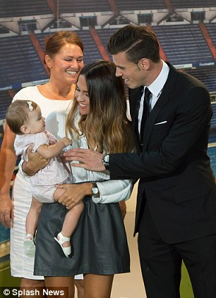 Family guy: Bale with girlfriend and daughter at Real Madrid