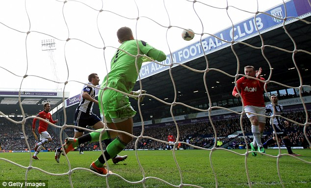 Back on track: United eased to victory over West Brom last weekend with Wayne Rooney among the goals