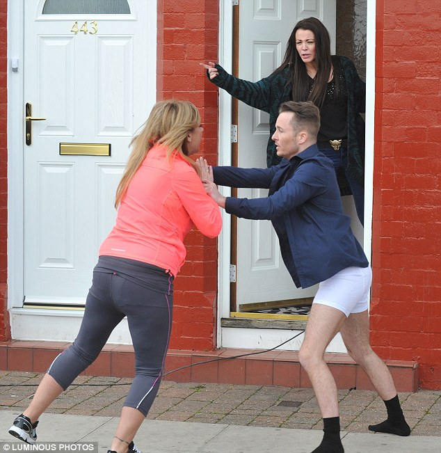 Break it up: The cast member Tony is seen in his boxers coming out of a suburban house in Dingle to calm a blonde woman down