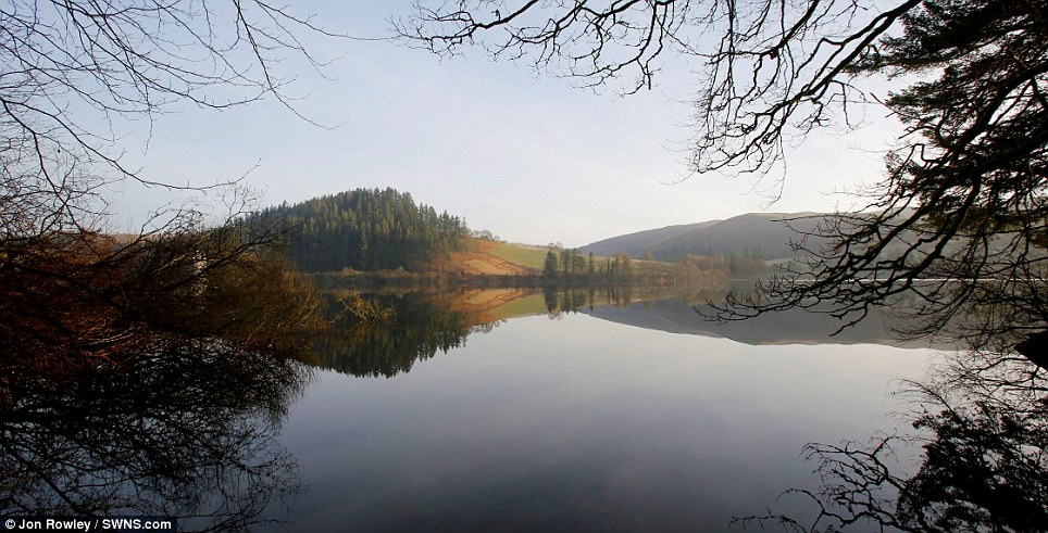 Stunning landscape: The rising sun showed off Lake Vyrnwy in Powys to perfection this morning, and more warm days are forecast