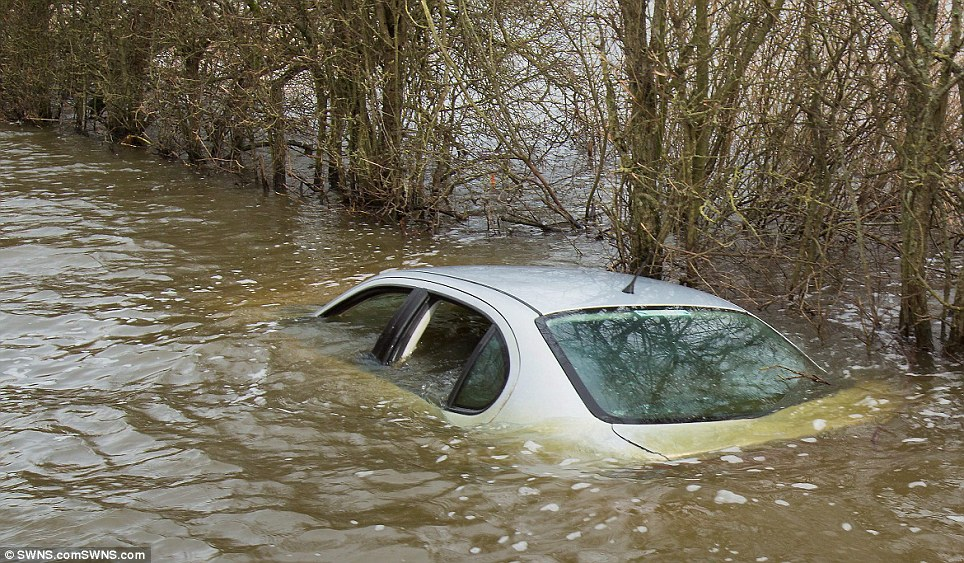 The car, which was stuck in a flood in Muchelney, Somerset, became a symbol of the devastation suffered in the west country by this winter's floods