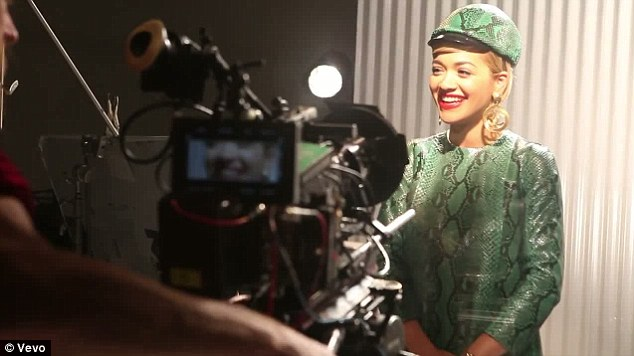 Cheerful: Rita beams as she poses in front of the camera