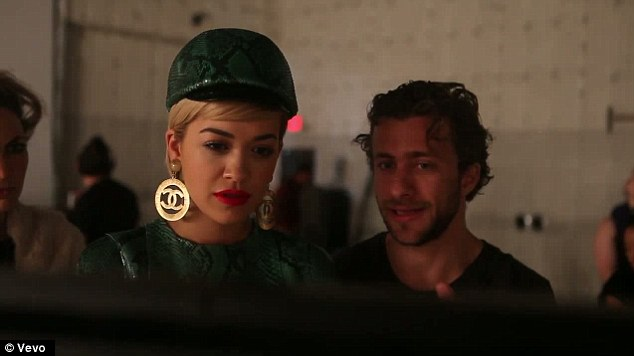 Chic accessories: Rita teamed an army-style look with Chanel earrings