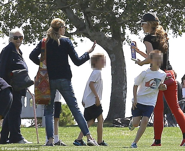 Family outing: Julia and her sons Phinnaeus, nine, and Henry, six, were joined by the star's mother Betty Lou Motes as they played in the park
