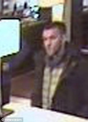 A suspect is captured on CCTV at the Holiday Inn in West Bromwich, West Mids stealing a poppy collection box.