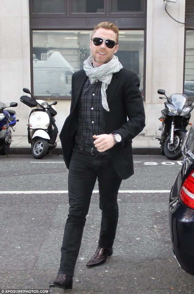 In the boy zone: Ronan looked very youthful as he headed to the studios where he and fellow band member Shane Lynch were being interviewed