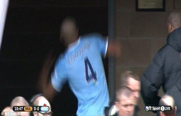 Angry man: Kompany kicked the wall of the tunnel on his way back to an early bath
