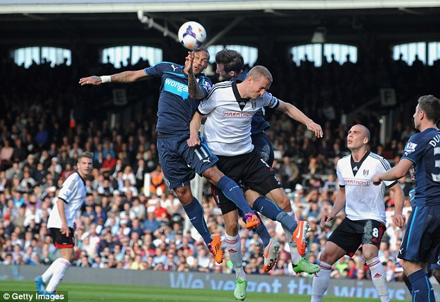 Up in the air: Brede Hangeland (R) challenges Yoan Gouffran as both sides seek to break the deadlock