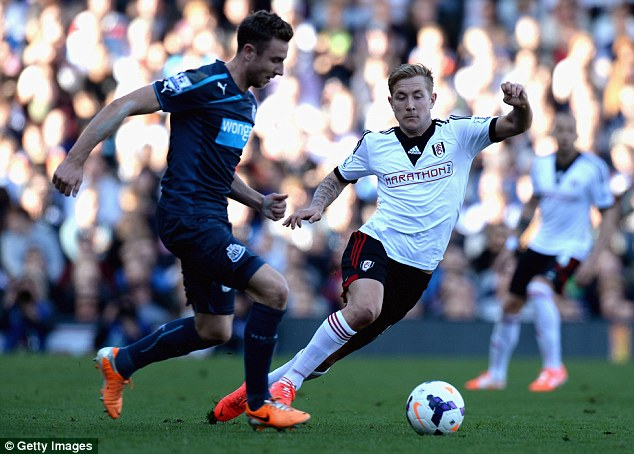 Cotage industry: Lewis Holtby of Fulham chases down Newcastle's Paul Dummett