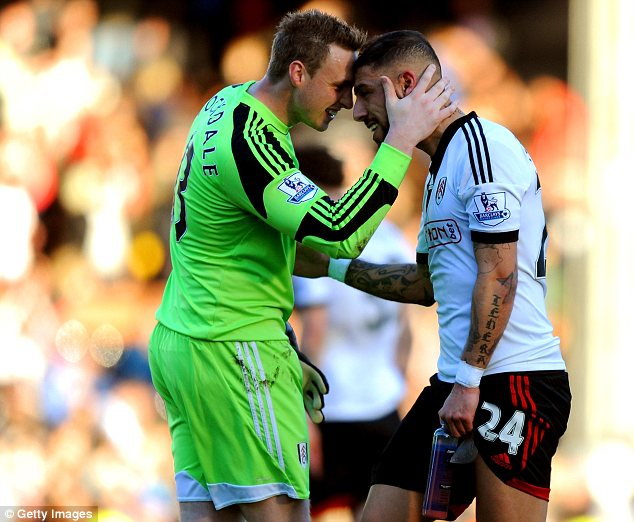 Top man: Goalscorer Ashkan Dejagah is congratulated by man of the match David Stockdale