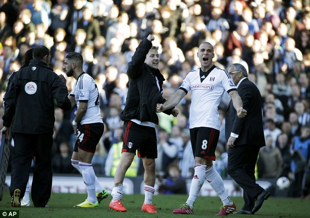 Delight: Fulham's Pajtim Kasami and Lewis Holtby, centre, celebrate victory