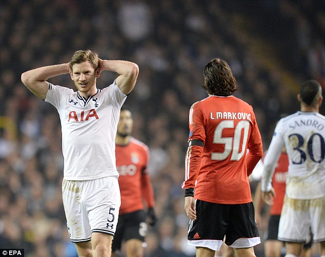 Poor week: Tottenham were beaten 4-0 by Chelsea and 3-1 by Benfica in a disastrous week for their hopes in the Premier League and Europa League