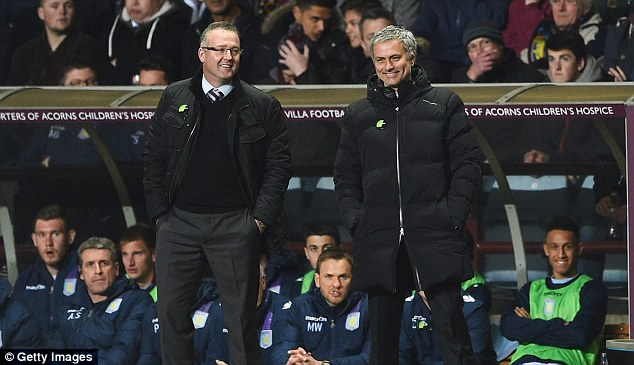 Calm before the storm: Paul Lambert (left) shares a joke with Mourinho during the game