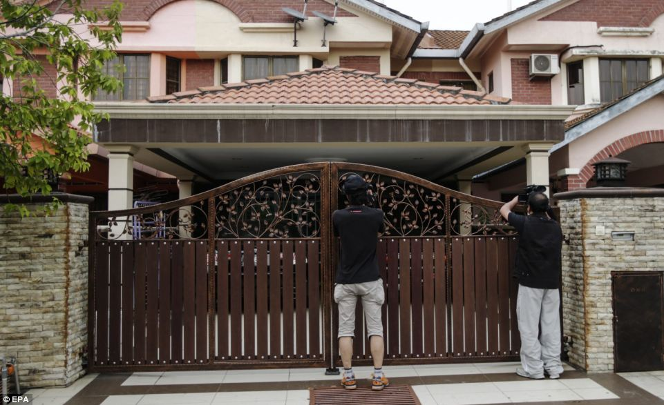Hunt: Investigators have riaded the houses of both pilots. Pictured is where co-pilot Hamid lives in an upmarket Kuala Lumpur suburb
