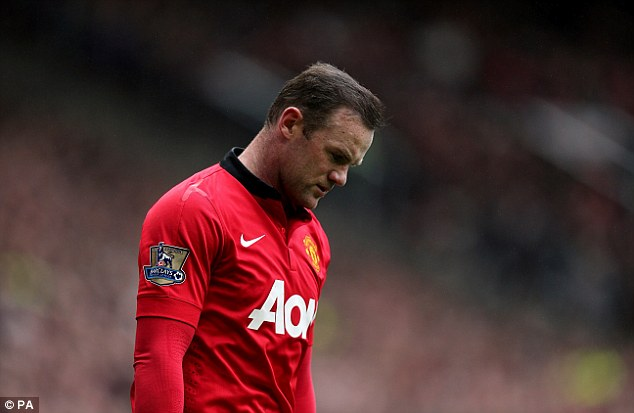 Head down: Rooney says the 3-0 defeat to Liverpool was a nightmare