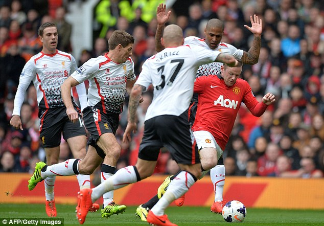 No room to breathe: Rooney is surrounded by Liverpool players as he attempts to make inroads