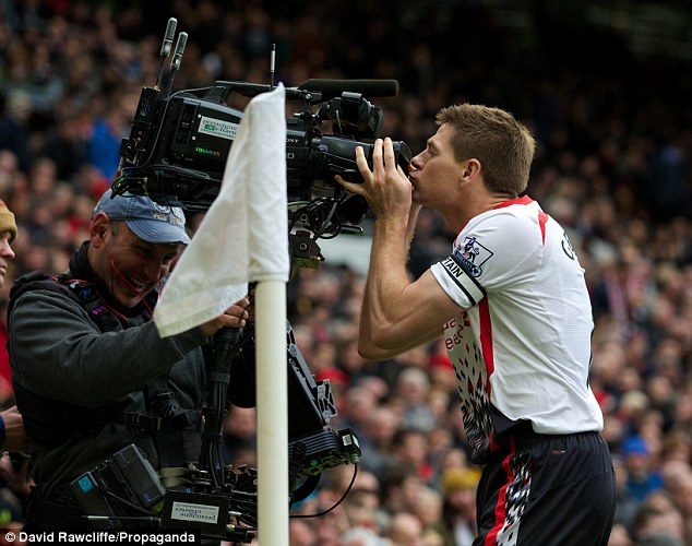 Back again: Gerrard celebrates scoring the second goal by kissing the camera, just as he did five years ago