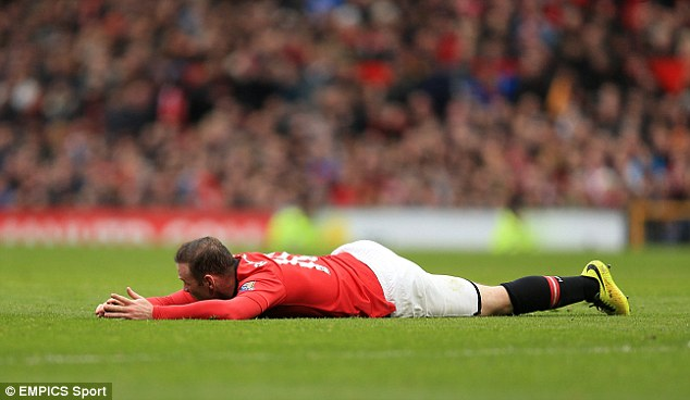Flattened: Manchester United's Wayne Rooney lies flat out on the Old Trafford pitch