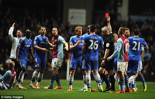 Off: Referee Chris Foy handed red cards to both Willian and Ramires during defeat at Villa Park
