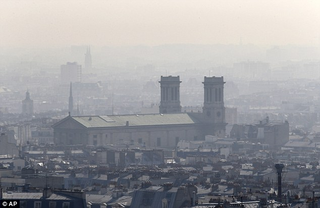 The Saint Vincent de Paul church is seen through the smog. Pollution is believed to be lingering because of a combination of bright sunny days and cold nights, say experts
