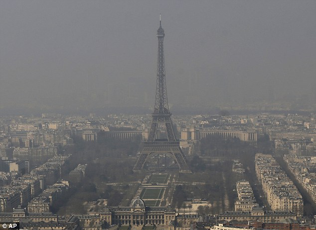 The Eiffel Tower, is barely seen through the smog from Paris. Emissions from the French capital could be blown over by strong south easterly winds until Friday, according to the Met Office