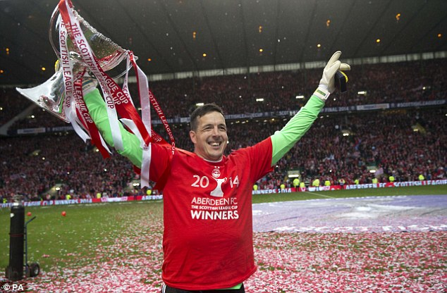 Grinning: Goalkeeper Jamie Langfield couldn't stop smiling after the penalty win on Sunday afternoon