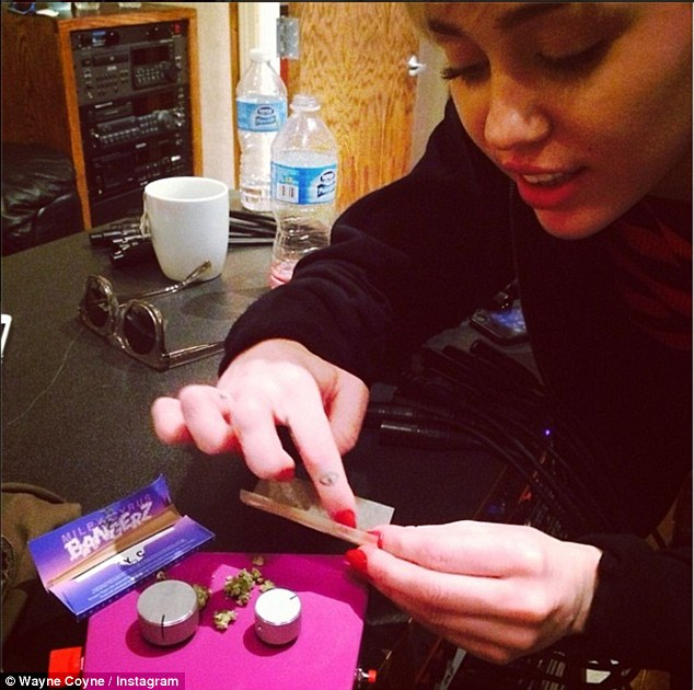 Same hobbies: The Flaming Lips frontman recently shared a snap of the Wrecking Ball singer rolling a suspicious looking cigarette, saying: 'Yup...... Recordin with Miley... High as f**k....'