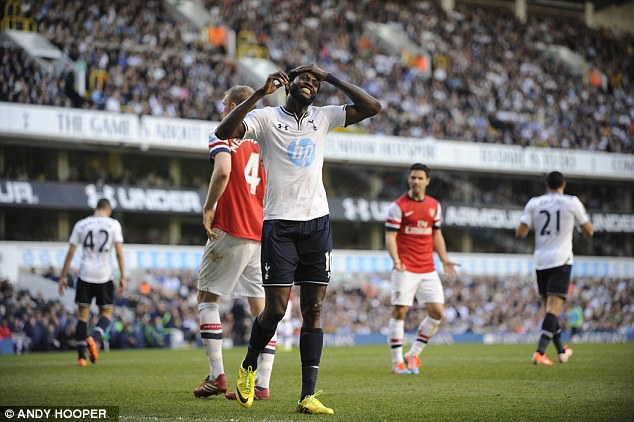 Agony: Tottenham striker Emmanuel Adebayor, formerly of Arsenal, reacts to a missed chance