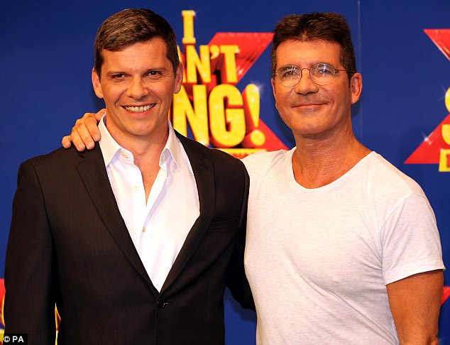 Side by side: Cowell is said to be a fan of the irreverent send up, which launches in London on March 26