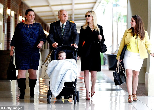 Formidable team: Former Louisiana Gov. Edwin Edwards, 86, walks with his wife Trina Scott Edwards (2R) and his son Eli Edwards this morning - Edwards' family are the stars of their own A&E show