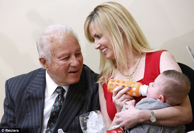 Happy family: Former Louisiana Governor Edwin Edwards, 86, his wife Trina Scott, 35, and their baby Eli attend a luncheon where Edwards announced his run for congress in Baton Rouge, Louisiana on March 17, 2014