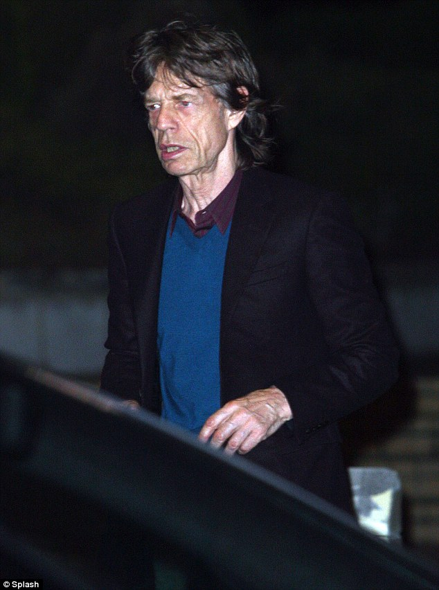 In shock: Mick Jagger is seen leaving Coco's Restaurant in Perth, Western Australia, just moments after hearing the news of girlfriend L'Wren Scott's death