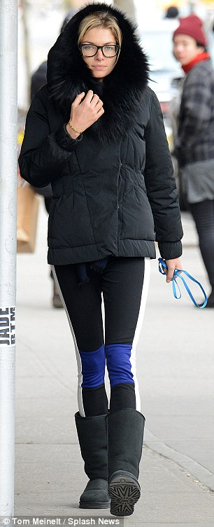 All rugged up: The 27-year-old kept the chill out in a puffer jacket, tights and a very Australian choice of Ugg boots