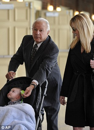 Father: Edwin Edwards, his wife Trina Scott and their baby Eli speaking at the luncheon where he ended months of speculation and announced his run for the US Congress