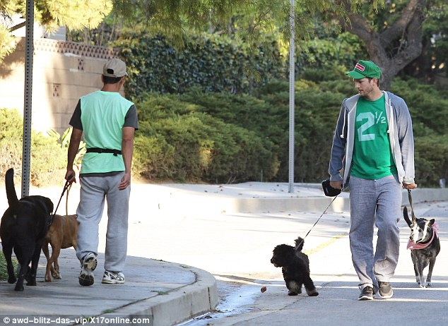 He's not the only one! Another man was spotted wearing green and taking two pups for a walk