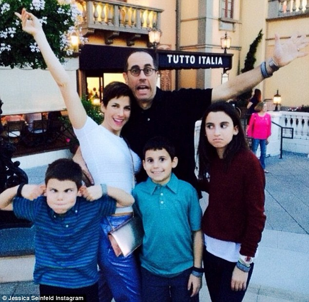 Vacation time: Mr and Mrs Seinfeld pose with their three children on a trip to Disney World Italy last month