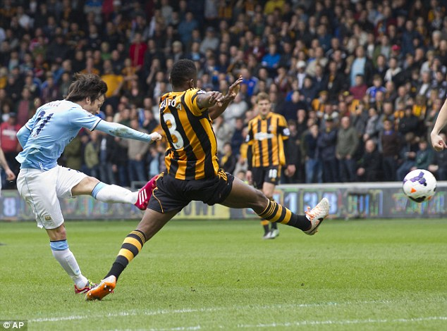 Beauty: Manchester City's David Silva curls in a cracker from outside the box in the win over Hull this weekend