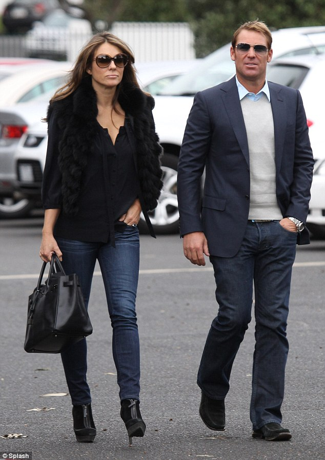 New fan: Shane Warne [seen here with ex-girlfriend Elizabeth Hurley] tweeted: 'Was just sent some pictures, wow, some people move on quickly. Maybe now it's time to take up my single friends (sic) suggestions & join tinder!'