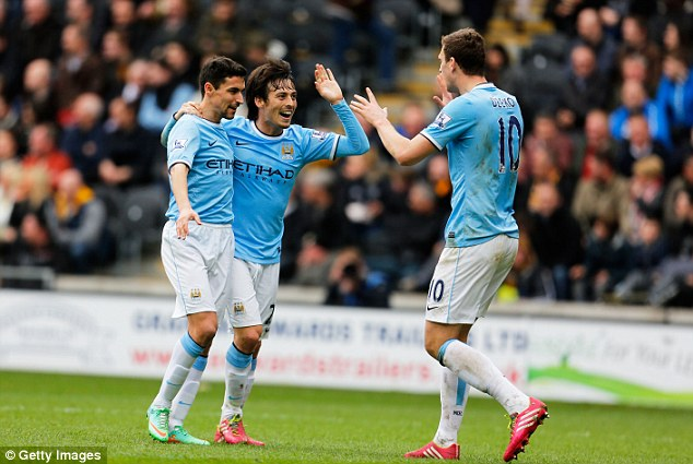 Cruising to the title? Manchester City's Jesus Navas (left), David Silva (centre) and Edin Dzeko (right)
