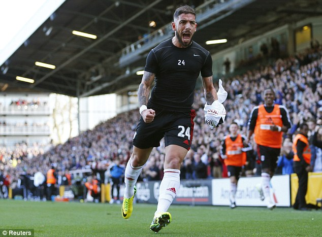 Rare victory: Ashkan Dejagah celebrates scoring Fulham's winner against Newcastle on Saturday
