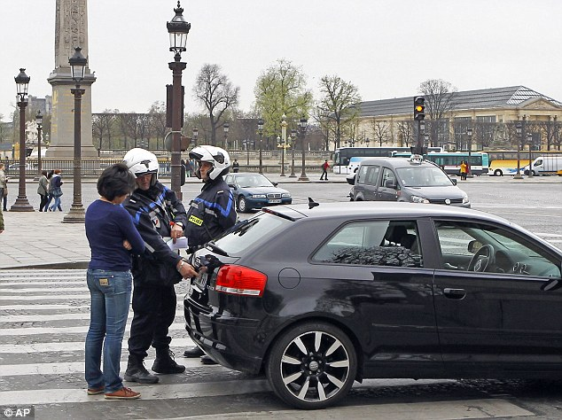 Restrictions: Parisians can only use their cars every other day under new rules introduced in an attempt to reduce air pollution in the city